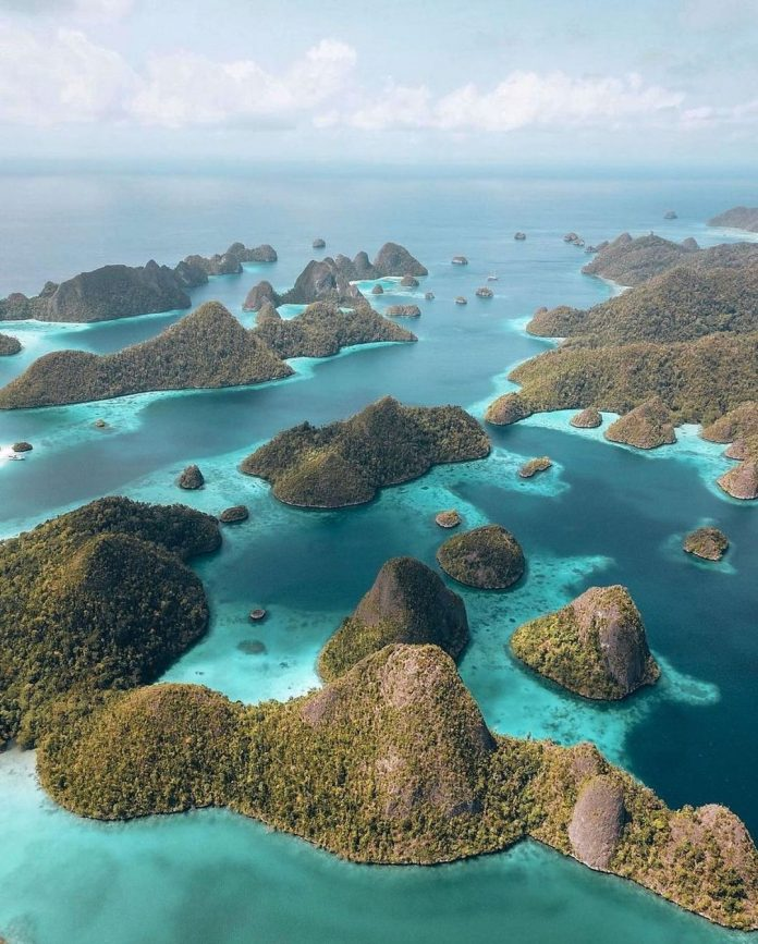 Forget the congested traffics of cities, and discover paradise in Raja Ampat, We...